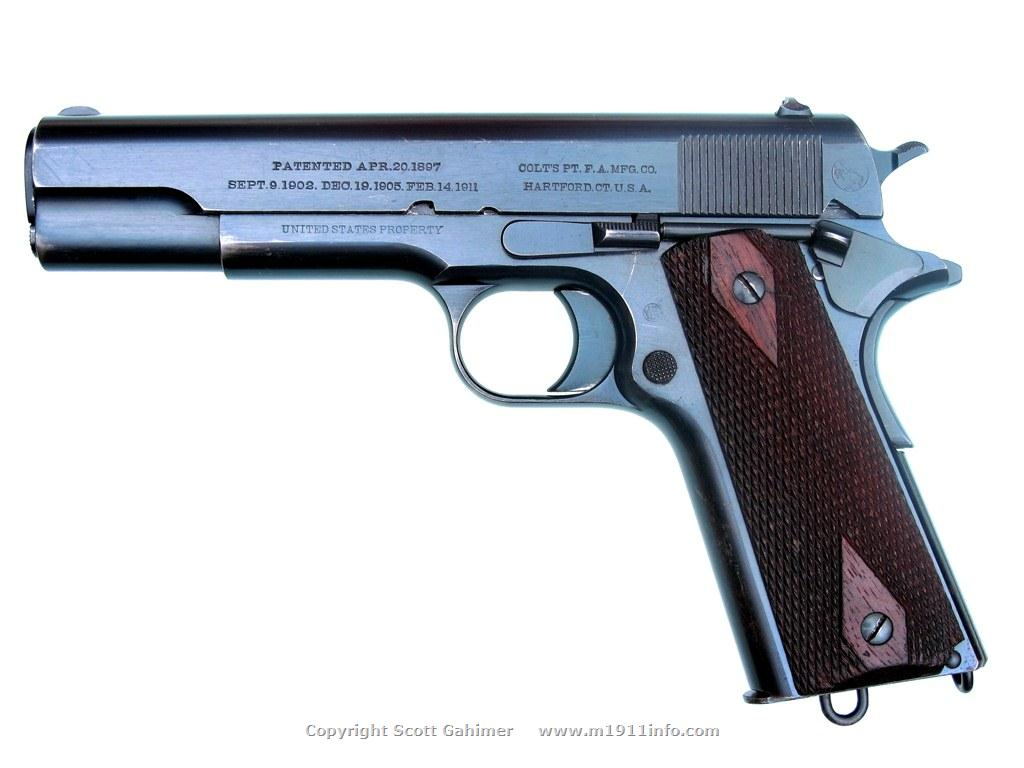 Early 5-digit s/n 1912 Colt M1911 pistol.